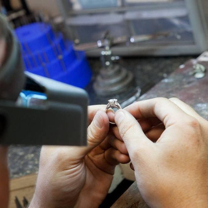 Image of Larry Hustedt performing expert diamond ring inspection